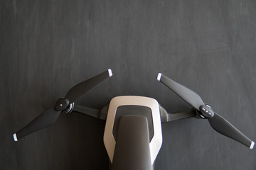Wall Mural - Top view macro. Details of the drone . Copy space. Innovation photography concept. Digital camera on the sky. mate color. Close up drone camera