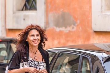 happy woman walking in city