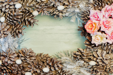 Empty place for text on a blue wooden background, copy the spray. Christmas arrangement of cones and flowers.