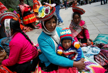 People gather outside a polling station during Peruvian municipal and regional elections in Cuzco