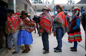 People wait on line to vote during Peruvian municipal and regional elections in Cuzco