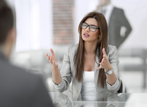 Manager talking with a client in a modern office