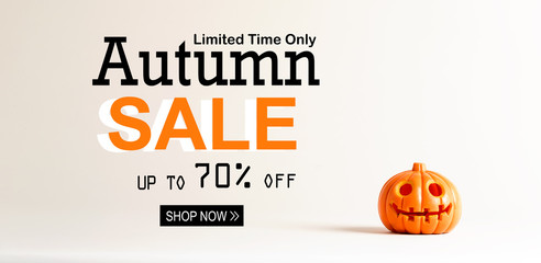 Halloween sale with small orange pumpkin lantern