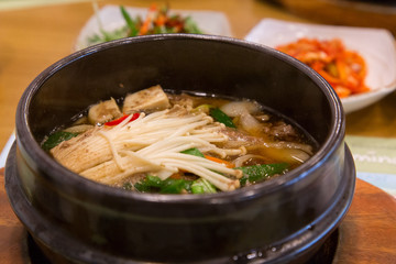 A bowl of Bulgogi, Korean local dish that has beef, mushrooms, kimchi and other vegetables.