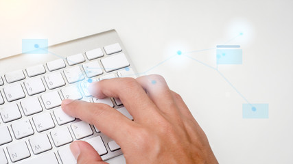 Sticker - fingers are pressing enter the keyboard on white table.