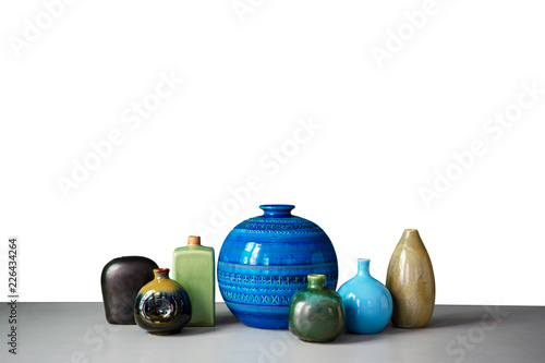 Set Of Vases On The Table And Gray Walls Stock Photo And Royalty