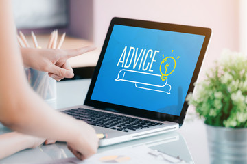 Close up businesswoman hand point at laptop screen with advice funciton on screen at office.business expert advice solution concept.