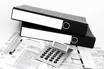 Ring binders with tax form banknote calculator office