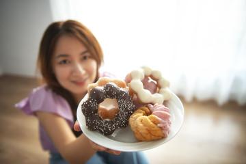 Woman enjoying eating a doughnut