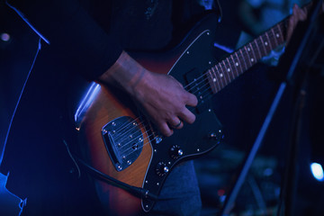 guitarist with guitar, electric guitar, guitar on the main plan, disco, group performance