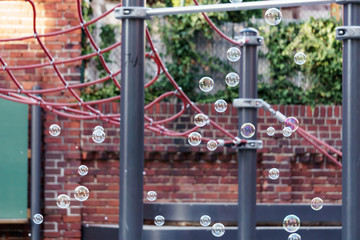 soap bubbles in the air on a kids playground