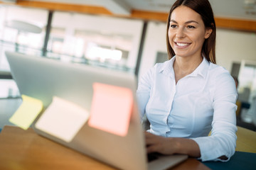 Portrait of businesswoman working on computer in office