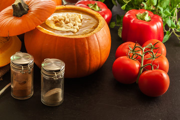 Pumpkin soup with cream in a pumpkin