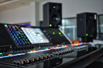 Audio controls in media control room.