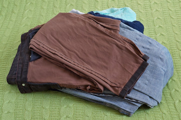 A stack of clean, washed women's jeans trousers