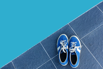 Blue sneaker with abstract background.