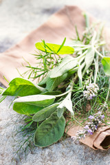Provence Herbs. Rustic bouquet with salvia, lavender, dill, rosemary on  stone textural background