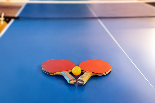 racket for tennis or ping pong on a blue table game. Table tennis.