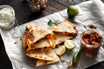 Vegetarian snacks quesadilla vegetables cheese dark wooden table