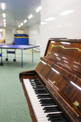 Moscow, Russia - September, 23, 2018: The image of a piano close up in a sport hall in Moscow privet school