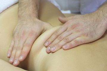 Hands of a massage therapist close up