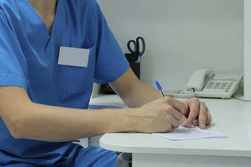 Writing doctor's hands