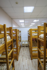 Moscow, Russia - September, 24, 2018: Interior of a kindergarten bedroom with two-level beds in Moscow privet school