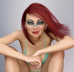 Lächelnde sitzende Frau mit Make-up und wehenden roten Haaren