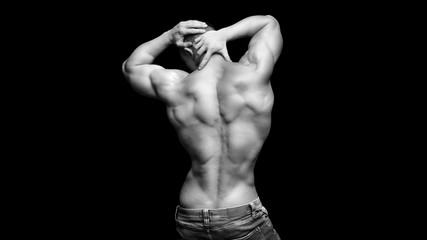 sporty man with fit shape body on a dark background with copyspace.