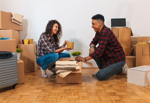 Happy young couple moving into their new home.