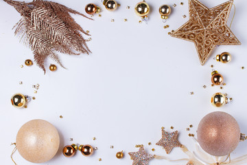 Christmas flat lay styled frame with golden decorations, copy space on white desktop