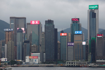 Neon signs illuminate Chinese listed companies in Hong Kong