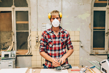 portrait of a worker with mask and headphones
