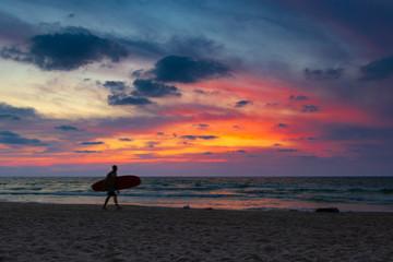 Surfer in sunset light (horizontal)