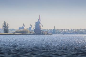 Water landscape with windmills at Zaanse Schans near Amsterdam, Netherlands