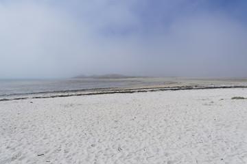 Sea mist rolls away.