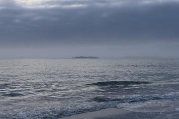 Heavy sea mist and dark skies