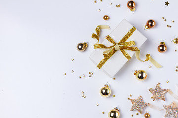Christmas flat lay scene with git box with golden bow knot, copy space on white background