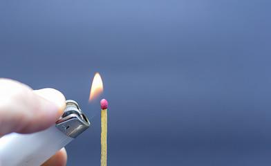 lighting a matchbox with lighter