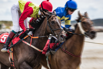 Close-up on jockey and race horse galloping at speed, motion blur zoom effect