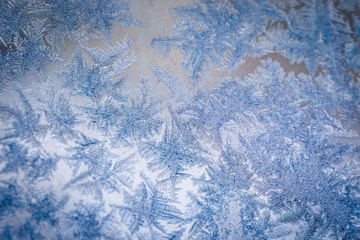 Winter ice pattern on the frozen window. Texture, background for inserting text. New Year theme. Winter. Cold.