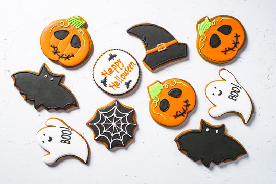 Halloween food bakground -Gingerbread Cookies on white table.