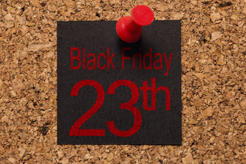 Mural message. Reminder of Black Friday. Red thumbtack. Text: Black Friday 23th