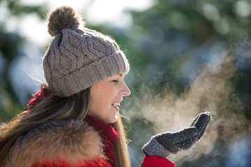 Fresh breath in frozen winter day of young happy woman