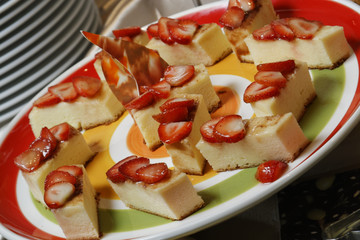 Classic Vanilla Flan is a dessert with creamy vanilla custard accented with a hint of cinnamon and lemon, swimming in luscious caramel sauce adorned with strawberries.