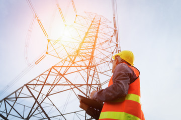 Engineering working on High-voltage tower, Check the information on paper.