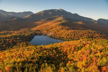 Morning light illuminates the fall color in the Adirondack Mountains