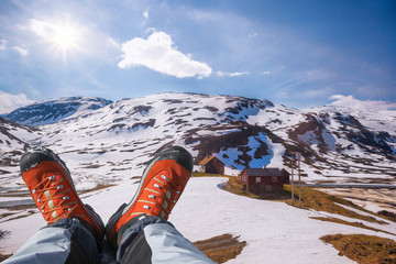 Hiking boots against fjords in Norway