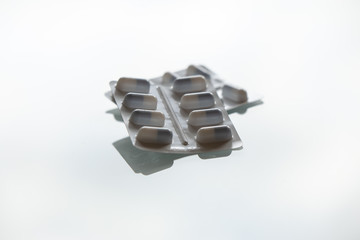 Medication pill packages on a white background