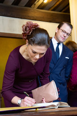 Sweden's Crown Princess Victoria and Prince Daniel sign the visitors' book during the inauguration of the Bernadotte Museum as part of a visit to mark the Bicentenary of Bernadotte on the Swedish throne in Pau